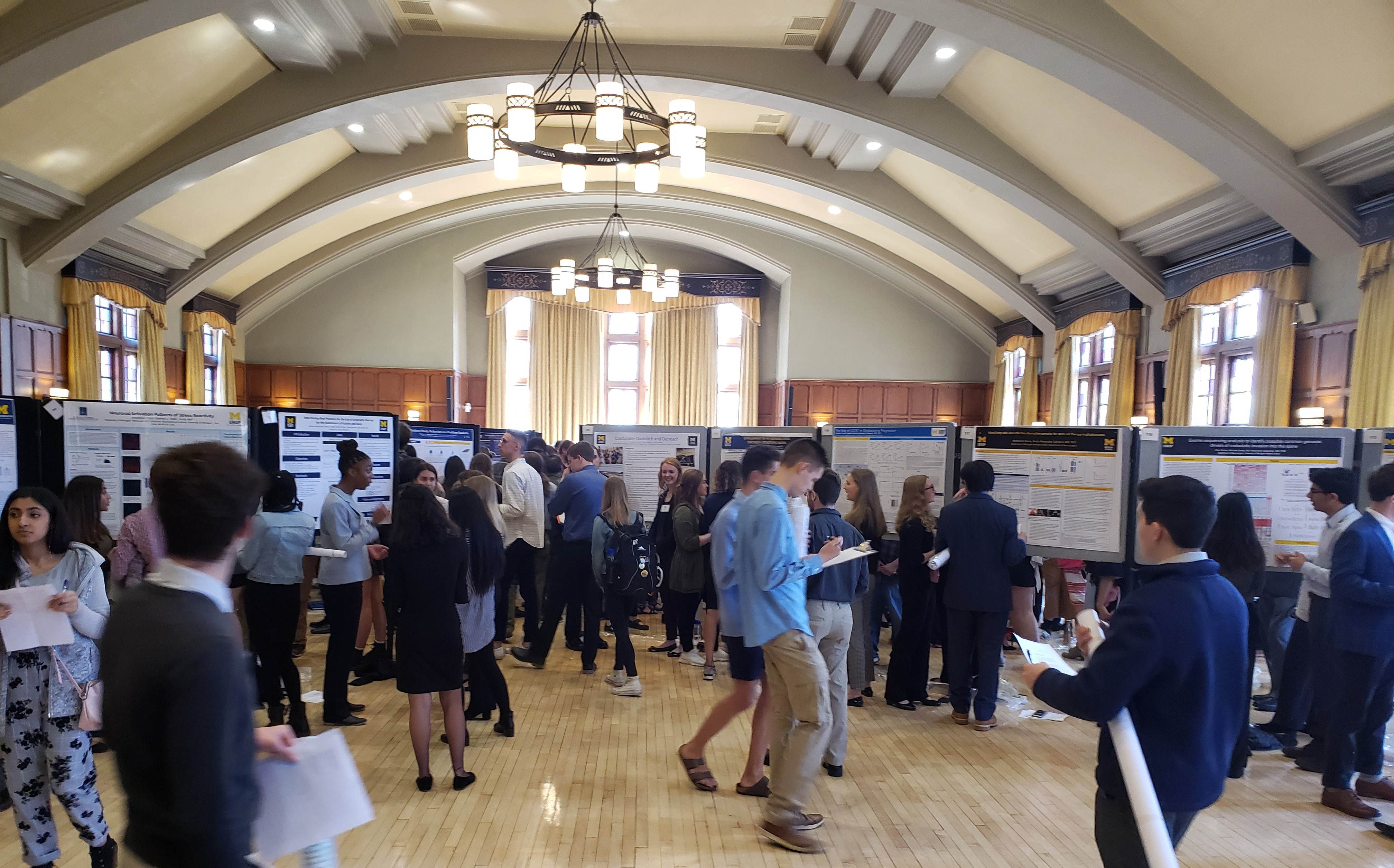 View of the League Ballroom filled with UROP students and their posters.