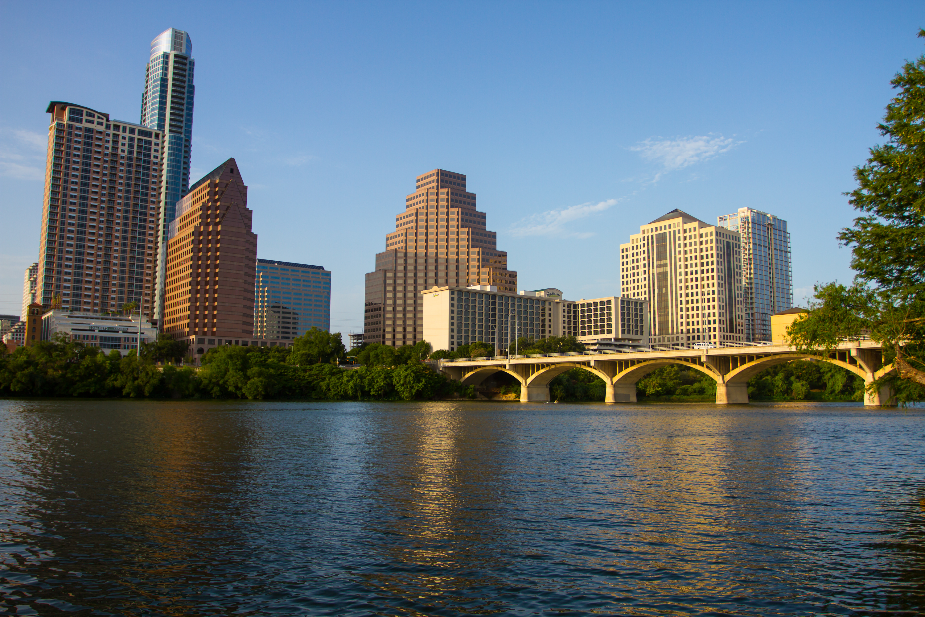 Photo of Austin city skyline including river and bridge