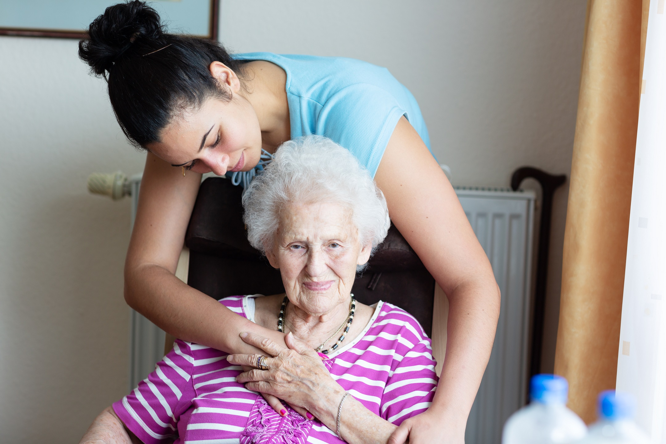younger woman embracing older woman