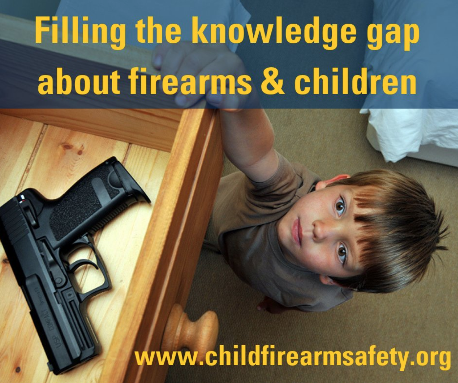 A child reaches up into a drawer containing a gun.
