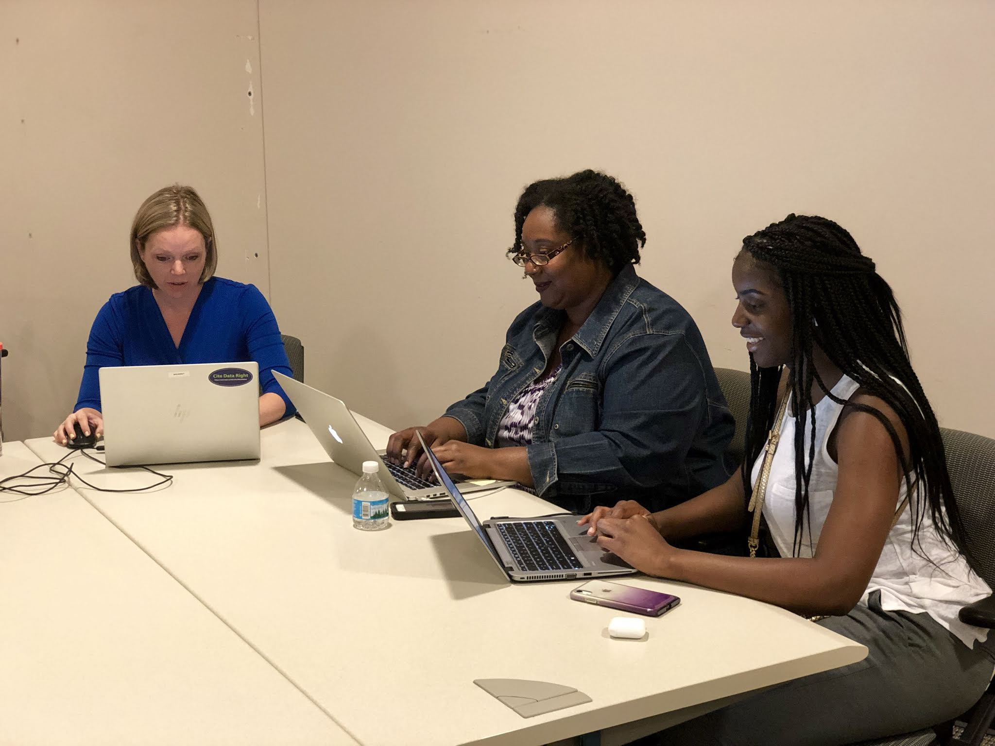 Ann, Dory and Mi'Lisa working during the Tweetchat
