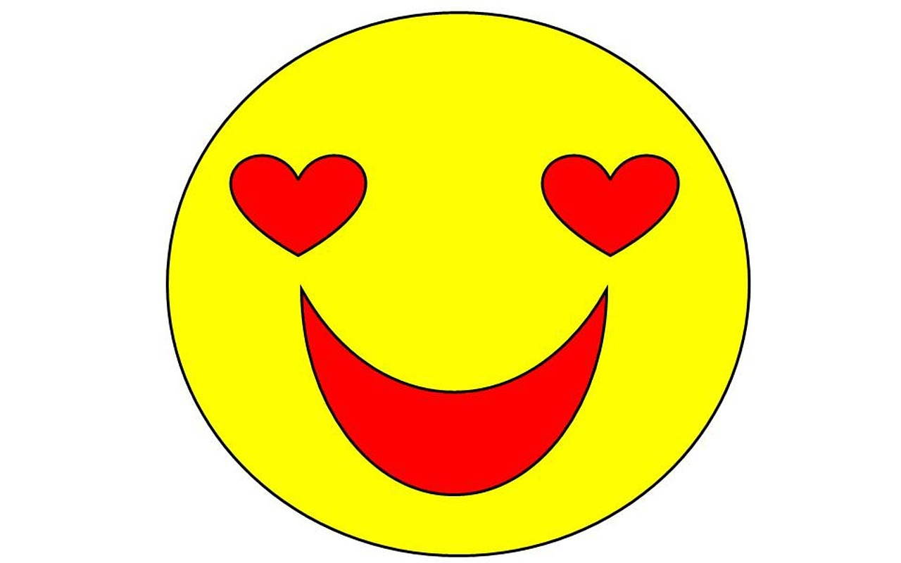 Yellow smiley face with hearts for eyes